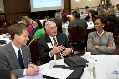 Associate Provost Jack Finney and Chancellor Bernadette Gray-Little participate in tabletop discussions