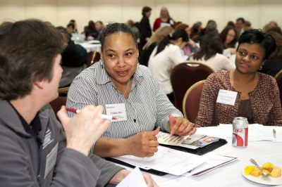 Participants engage in tabletop discussions